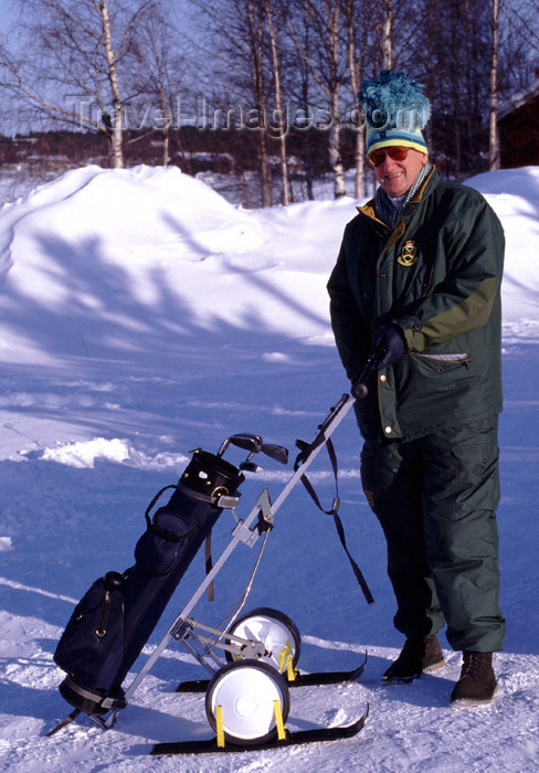 fin112: Finland - Lapland - Rovaniemi - Arctic golfer in the snow - Arctic images by F.Rigaud - (c) Travel-Images.com - Stock Photography agency - Image Bank
