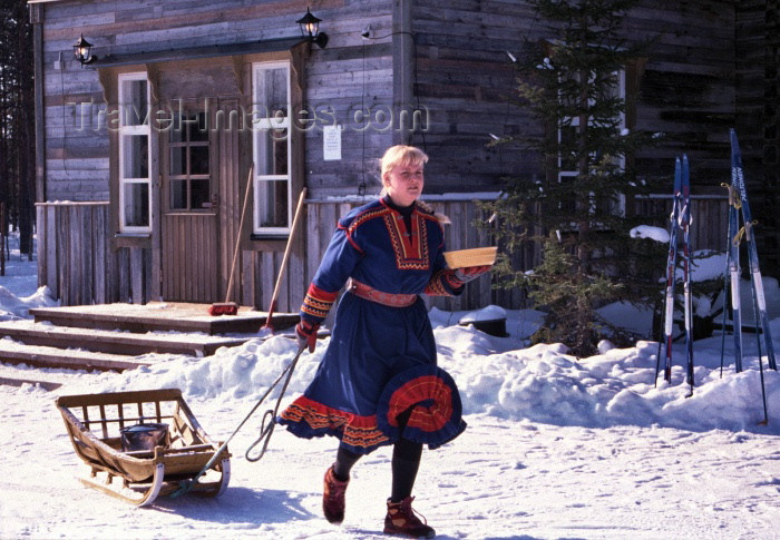 fin59: Finland - Levi: Sami farm - girl with sledge (photo by F.Rigaud) - (c) Travel-Images.com - Stock Photography agency - Image Bank