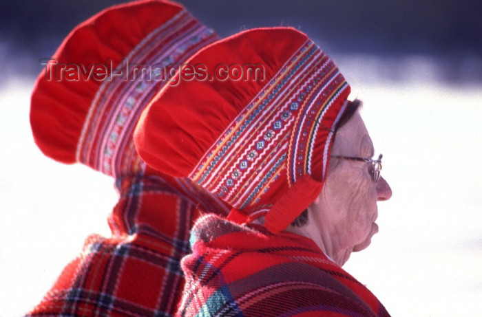 fin64: Finland - Lapland: Sami ladies - red hats (photo by F.Rigaud) - (c) Travel-Images.com - Stock Photography agency - Image Bank