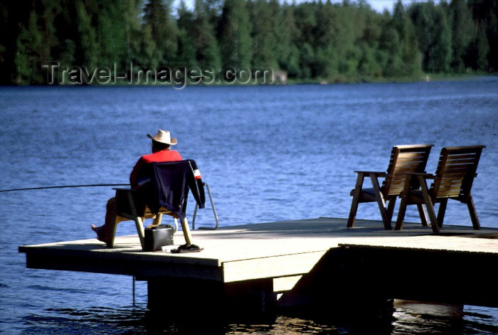 fin72: Finland - Tahko: fisherman - Lake Syväri (photo by F.Rigaud) - (c) Travel-Images.com - Stock Photography agency - Image Bank