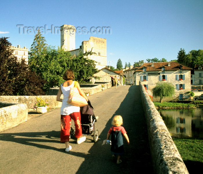 france1204: Bourdeilles, Dordogne, Aquitaine, France: toddler and woman with stroller cross the bridge towards Château de Bourdeilles - photo by K.Gapys - (c) Travel-Images.com - Stock Photography agency - Image Bank