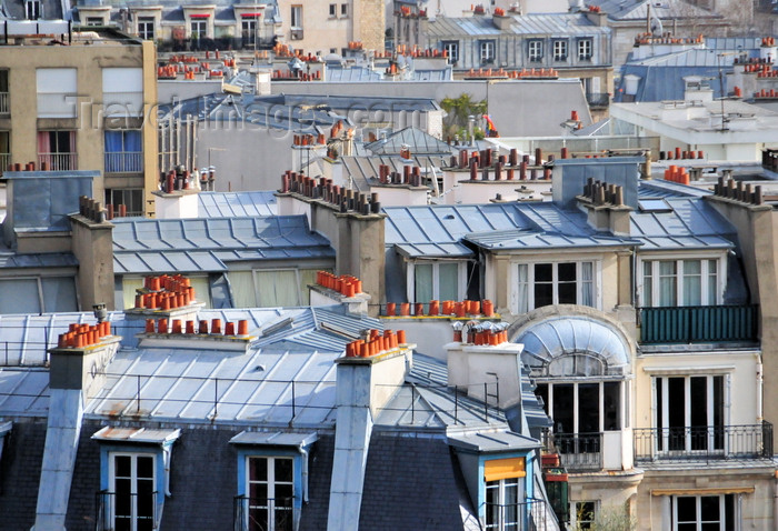 france574: Paris, France: mansard roofs and chimneys with red pipes of Montmartre district, 18e arrondissement - photo by M.Torres - (c) Travel-Images.com - Stock Photography agency - Image Bank