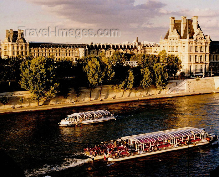 france paris bateau mouche near the louvre banks of the seine unesco world heritage site. Black Bedroom Furniture Sets. Home Design Ideas