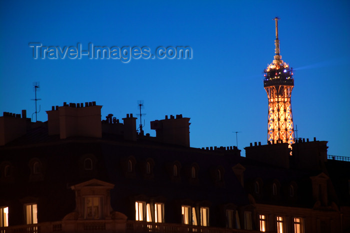 france615: Paris: Eiffel tower and Parisian roofs - nocturnal - photo by Y.Guichaoua - (c) Travel-Images.com - Stock Photography agency - Image Bank