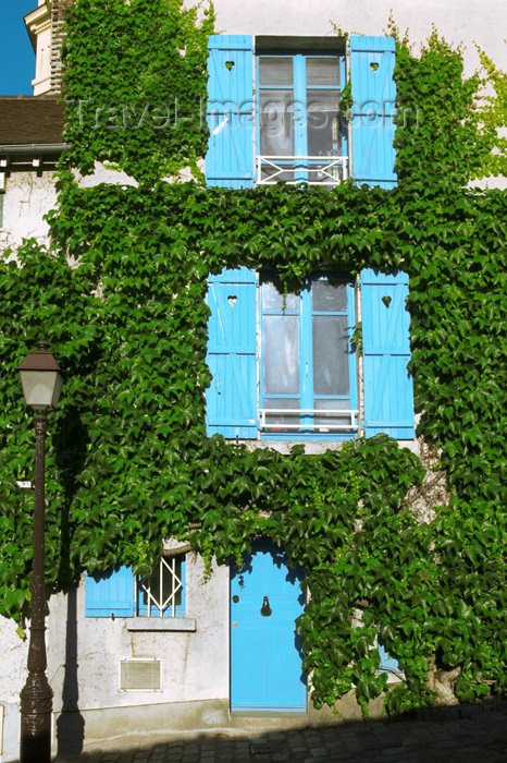 france770: Paris, France: Butte Montmartre - blue and green façade - photo by Y.Guichaoua - (c) Travel-Images.com - Stock Photography agency - Image Bank