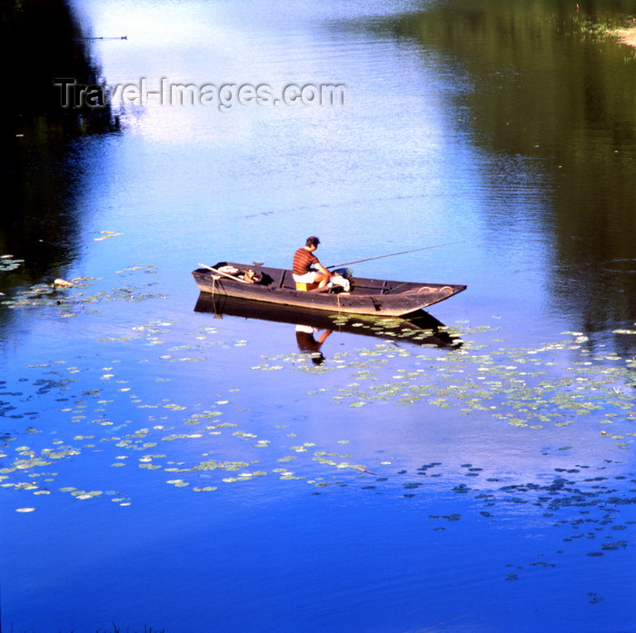 france83: Saumur, Maine-et-Loire, Pays de la Loire, France: angler on a small boat on the Loire river - blue sky reflection - photo by A.Bartel - (c) Travel-Images.com - Stock Photography agency - Image Bank