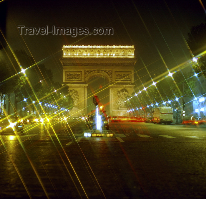 france931: Paris, France: lights with starburst effect and horse-chestnut trees along Avenue des Champs-Élysées - nocturnal view of the Arc de Triomphe - 8th arrondissement - photo by J.Fekete - (c) Travel-Images.com - Stock Photography agency - Image Bank