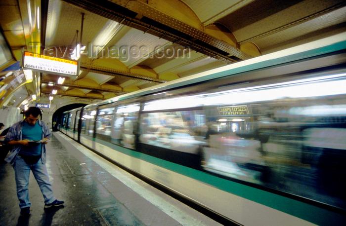 france999: Paris, France: man on metro platform - blurred train in motion, Champs-Élysées–Clemenceau station - 8e arrondissement - photo by K.Gapys - (c) Travel-Images.com - Stock Photography agency - Image Bank