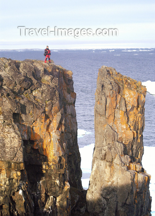 franz-josef10: Franz Josef Land - Wilzcek Land Island: man at cliff edge (photo by Bill Cain) - (c) Travel-Images.com - Stock Photography agency - Image Bank