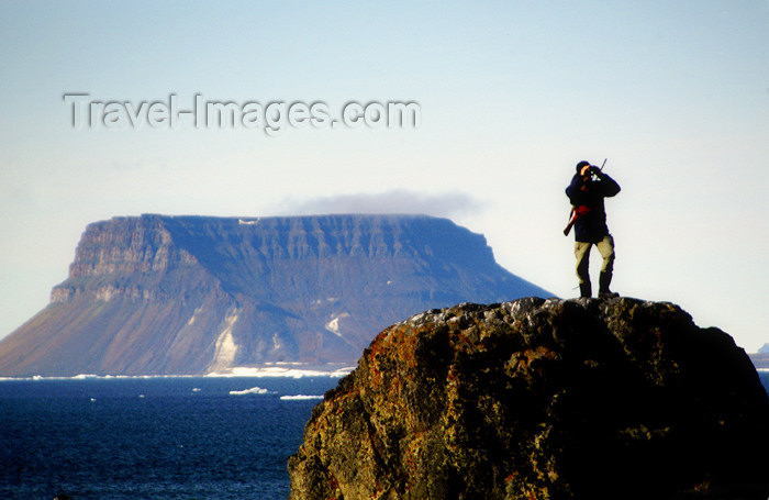 franz-josef20: Franz Josef Land Armed guard on lookout rock, Flora Island - Arkhangelsk Oblast, Northwestern Federal District, Russia - photo by Bill Cain - (c) Travel-Images.com - Stock Photography agency - Image Bank