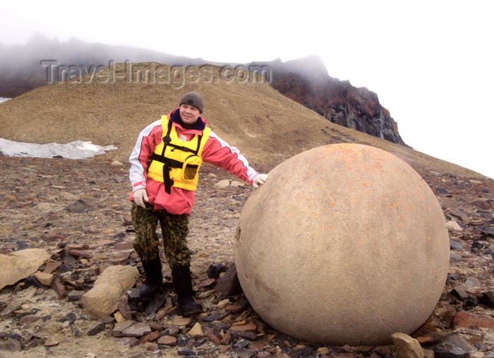 franz-josef51: Franz Josef Land Passenger next to spherical boulder , Champ Island - Arkhangelsk Oblast, Northwestern Federal District, Russia - photo by Bill Cain - (c) Travel-Images.com - Stock Photography agency - Image Bank