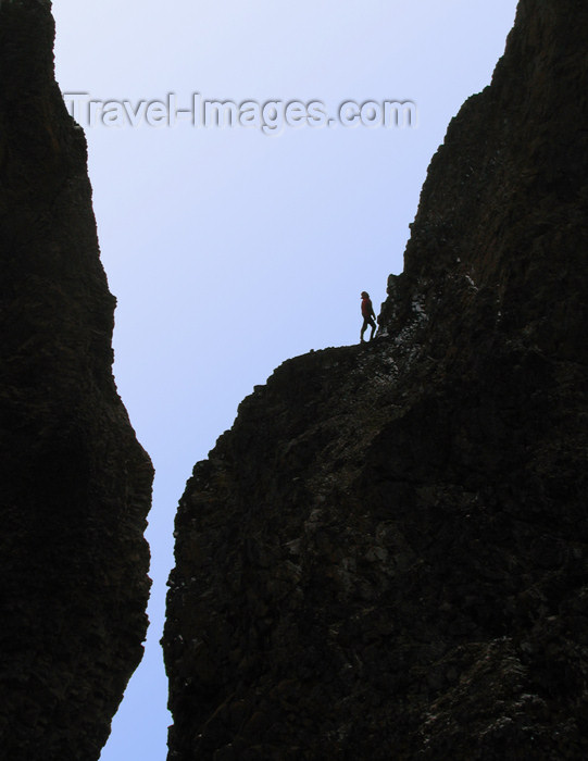 franz-josef53: Franz Josef Land Person climbing twin spires, Cape Tegethoff, Hall Island - Arkhangelsk Oblast, Northwestern Federal District, Russia - photo by Bill Cain - (c) Travel-Images.com - Stock Photography agency - Image Bank