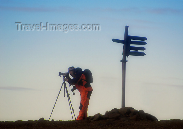 franz-josef55: Franz Josef Land Photographer next to sign on Hall Island - Arkhangelsk Oblast, Northwestern Federal District, Russia - photo by Bill Cain - (c) Travel-Images.com - Stock Photography agency - Image Bank