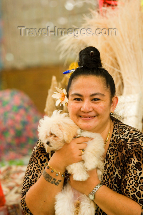 french-polynesia10: Papeete, Tahiti, French Polynesia: Tahitian woman wearing a leopard pattern, accompanied by her dog - photo by D.Smith - (c) Travel-Images.com - Stock Photography agency - Image Bank