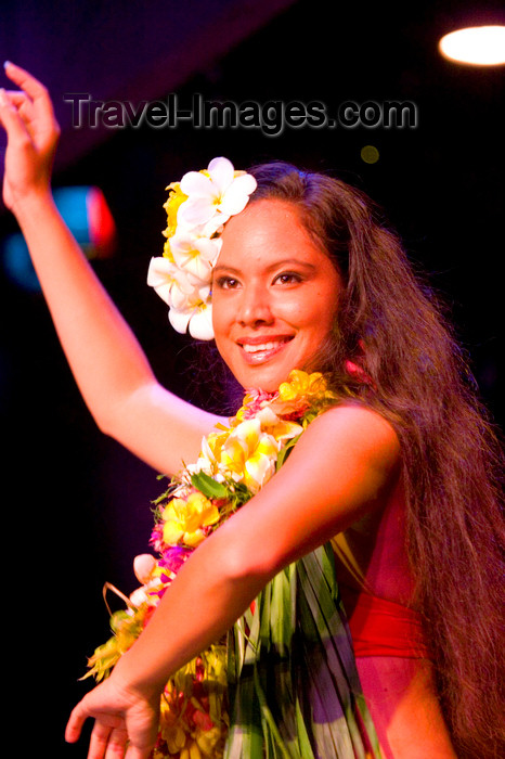french-polynesia5: Papeete, Tahiti, French Polynesia: Tahitian woman - dancer with Plumeria flowers in her hair - photo by D.Smith - (c) Travel-Images.com - Stock Photography agency - Image Bank