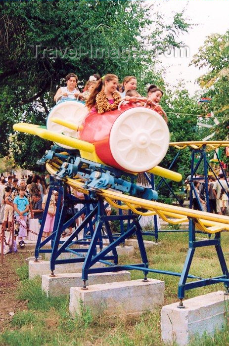gagauzia5: Comrat / Komrat, Gagauzia, Moldova: children on a roller coaster - amusement park in the town center - photo by M.Torres - (c) Travel-Images.com - Stock Photography agency - Image Bank