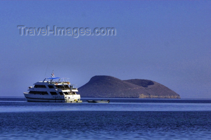galapagos18: Galapagos Islands - Isla Tortuga: vessel and volcano - only the upper ring of the crater breaches the surface of the Pacific ocean - photo by R.Eime - (c) Travel-Images.com - Stock Photography agency - Image Bank