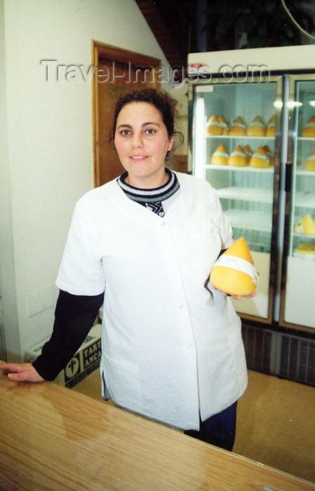 galicia32: Galicia / Galiza - Santiago de Compostela: rapariga vendendo queijo tetilha - young lady selling tetilla cheese - photo by M.Torres - (c) Travel-Images.com - Stock Photography agency - Image Bank
