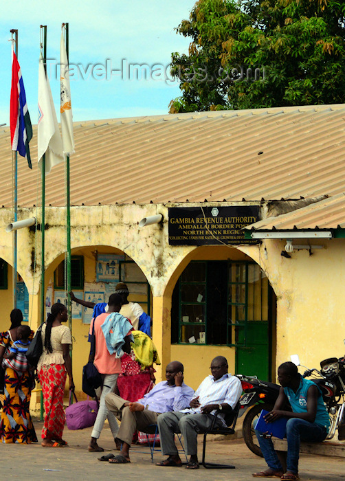 gambia118: Amdallai, North Bank division, Gambia: people sit and wait at the Amdallai / Karang border crossing between The Gambia and Senegal - Gambia Revenue Authority - photo by M.Torres - (c) Travel-Images.com - Stock Photography agency - Image Bank