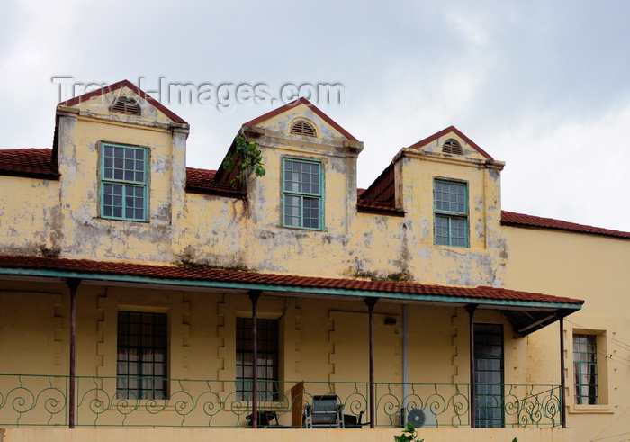gambia2: Banjul, The Gambia: British colonial architecture of the old Bathurst - ornate wrought iron balcony on a colonial building with mansard roof - Ecowas avenue - photo by M.Torres - (c) Travel-Images.com - Stock Photography agency - Image Bank
