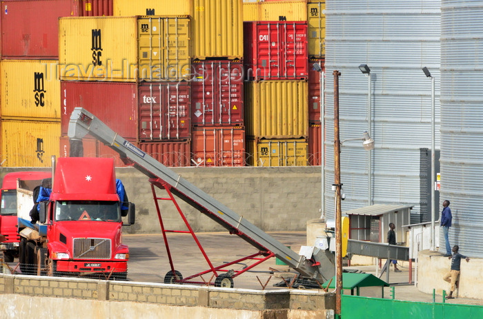gambia20: Banjul, The Gambia: port of Banjul - grain is loaded into trucks from the port's silos - grain elevator with containers in the background - photo by M.Torres - (c) Travel-Images.com - Stock Photography agency - Image Bank