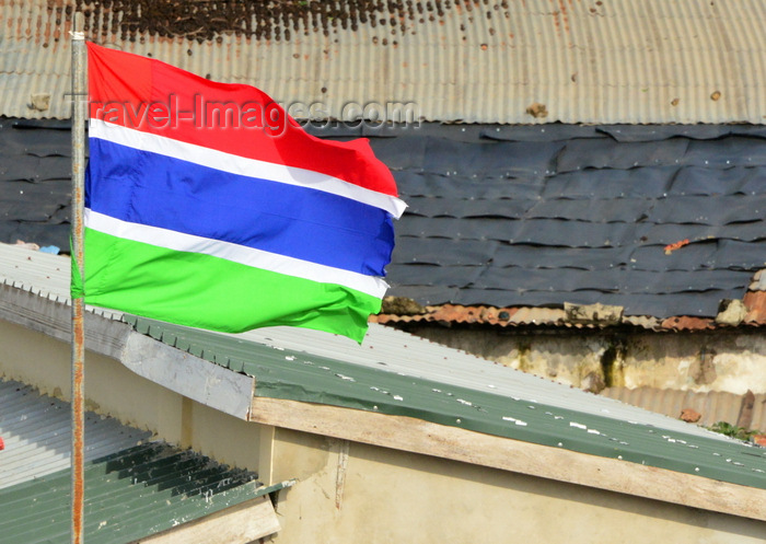 gambia21: Banjul, The Gambia: flag of Gambia and zinc roofs - three horizontal red, blue and green bands separated by two thin white fimbriations - photo by M.Torres - (c) Travel-Images.com - Stock Photography agency - Image Bank