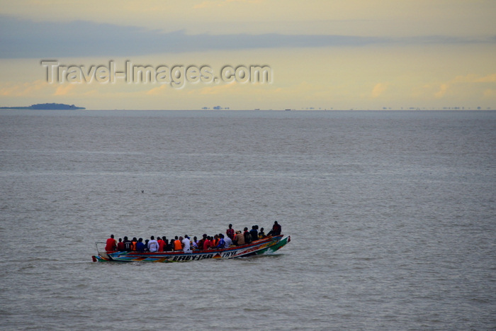 gambia32: Banjul, The Gambia: crowded small boat that provides informal transportation accross the river Gambia, as an alternative to the official ferries - photo by M.Torres - (c) Travel-Images.com - Stock Photography agency - Image Bank