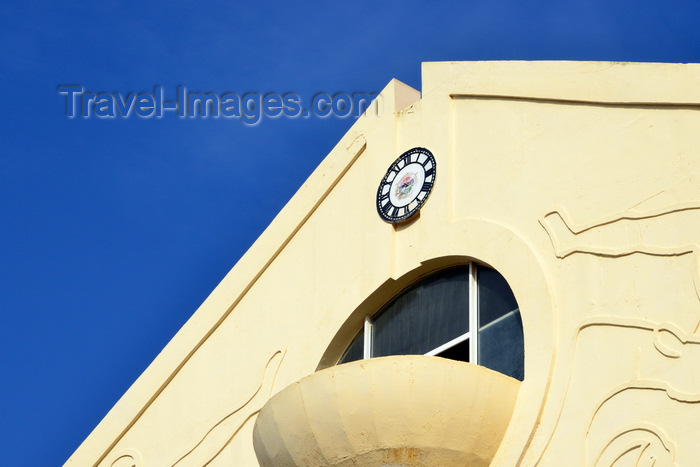 gambia56: Banjul, The Gambia: balcony and clock without hands, hollow-arched pediment of the triumphal arch at the entrance to the capital - Arch 22 - marks the coup d'etat of 1994 - photo by M.Torres - (c) Travel-Images.com - Stock Photography agency - Image Bank