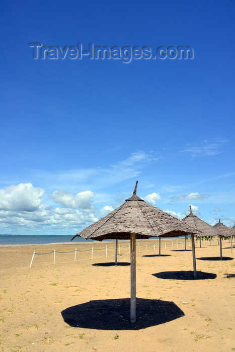 gambia64: Banjul island, The Gambia: beach with golden sand beach on the north shore of Banjul Island, near the Laico Atlantic hotel - beach umbrellas and deep blue sky - photo by M.Torres - (c) Travel-Images.com - Stock Photography agency - Image Bank
