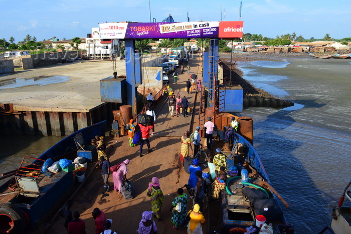 gambia71: Barra, The Gambia: ferry terminal pier - passengers leave the ferry, while trucks, mostly from Senegal, wait their turn to cross the River Gambia to Banjul - photo by M.Torres - (c) Travel-Images.com - Stock Photography agency - Image Bank