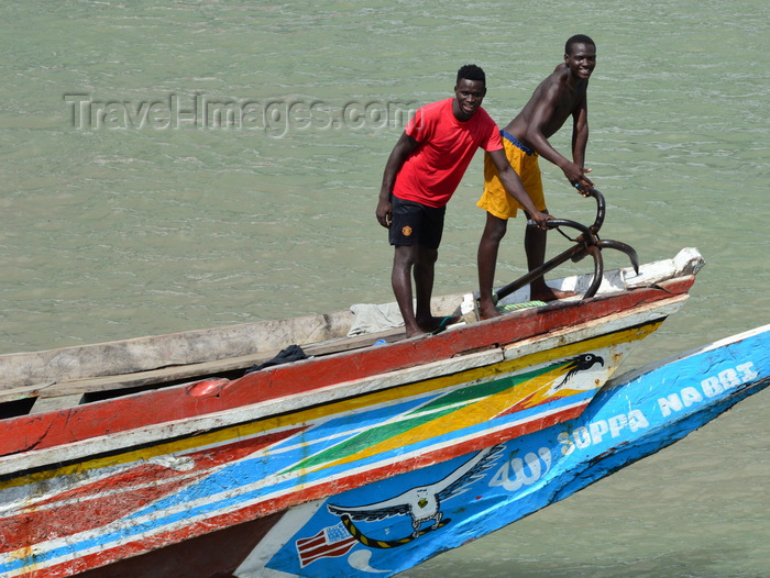 gambia78: Barra, The Gambia: Gambian sailors - fishermen preparing the anchor on the bow of a traditional wooden fishing boat - River Gambia estuary - photo by M.Torres - (c) Travel-Images.com - Stock Photography agency - Image Bank