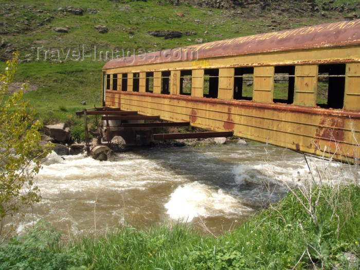 georgia101: Georgia - Mtskheta-Mtianeti region: railway car used as a bridge - photo by L.McKay - (c) Travel-Images.com - Stock Photography agency - Image Bank