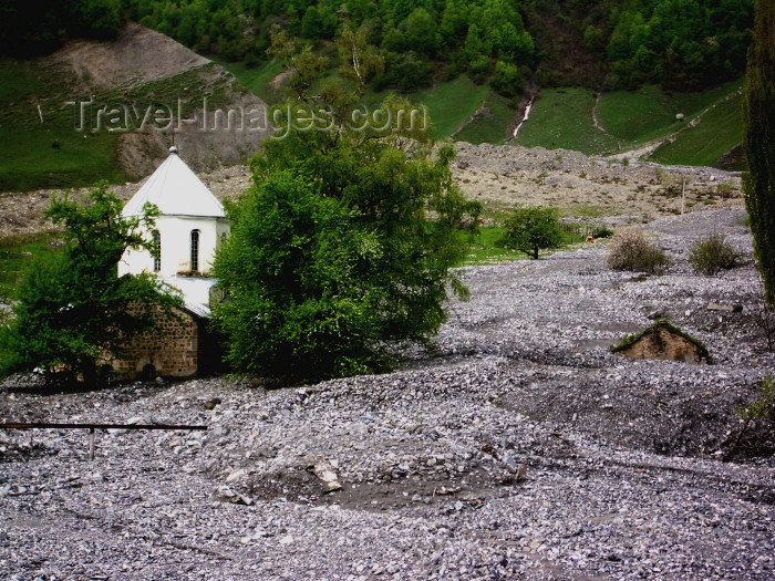 georgia102: Georgia - Mtskheta-Mtianeti region: church after a stone avalanche from the mountains - photo by L.McKay - (c) Travel-Images.com - Stock Photography agency - Image Bank