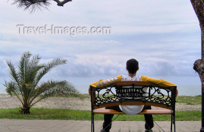 georgia138: Georgia - Batumi, Ajaria: waterfront - man sitting on a bench and looking at Black Sea - photo by S.Hovakimyan - (c) Travel-Images.com - Stock Photography agency - Image Bank