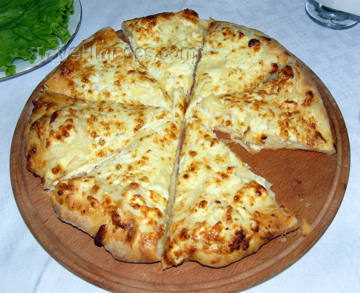 georgia163: Tbilisi, Georgia: khachapuri - flatbread filled with contrasting cheeses - traditional Georgian dish - Caucasian Foccacia - photo by N.Mahmudova - (c) Travel-Images.com - Stock Photography agency - Image Bank