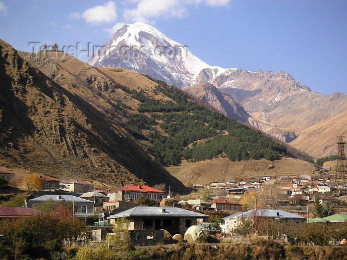 georgia59: Georgia - Kazbegi / Stepantsminda: view from the town square - Mt Kazbek and Gergeti - Georgian Military Highway - the mountain where Prometheus was chained - photo by Austin Kilroy) - (c) Travel-Images.com - Stock Photography agency - Image Bank
