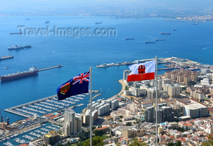 gibraltar59: Gibraltar: flag of Gibraltar (right) and the Government Ensign (left) - seen against the bay of Algeciras and the town - photo by M.Torres - (c) Travel-Images.com - Stock Photography agency - Image Bank
