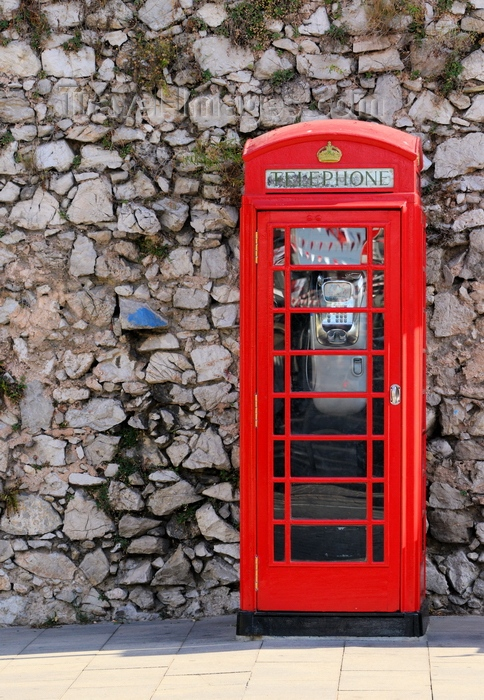 gibraltar98: Gibraltar: British phone booth at the Southport Gates - red telephone box designed by Sir Giles Gilbert Scott - K6 - photo by M.Torres - (c) Travel-Images.com - Stock Photography agency - Image Bank