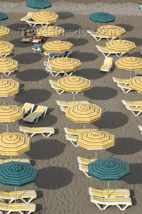greece308: Greece, Rhodes, New Town: beach umbrellas form geometric patterns on the beach of Rhodes' New Town - (c) Travel-Images.com - Stock Photography agency - Image Bank