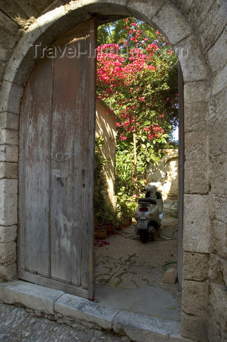 greece347: Greece, Dodecanese Islands, Rhodes: scooter in doorway of old house in Old Town - (c) Travel-Images.com - Stock Photography agency - Image Bank