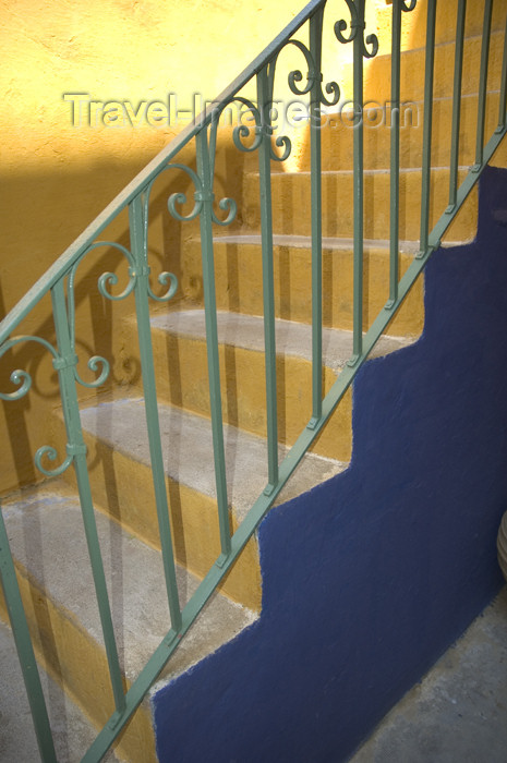 greece353: Greece, Dodecanese Islands, Rhodes: green painted stair guard against blue and orange painted steps - (c) Travel-Images.com - Stock Photography agency - Image Bank