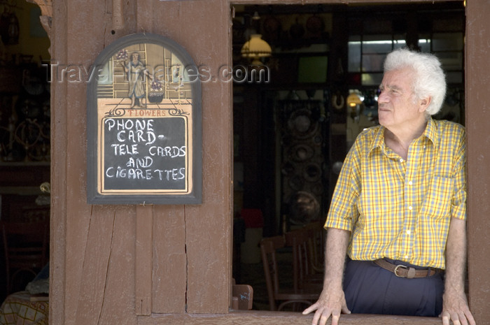 greece355: Greece, Dodecanese Islands, Rhodes: man looking out of old style coffee shop in Old Town - (c) Travel-Images.com - Stock Photography agency - Image Bank