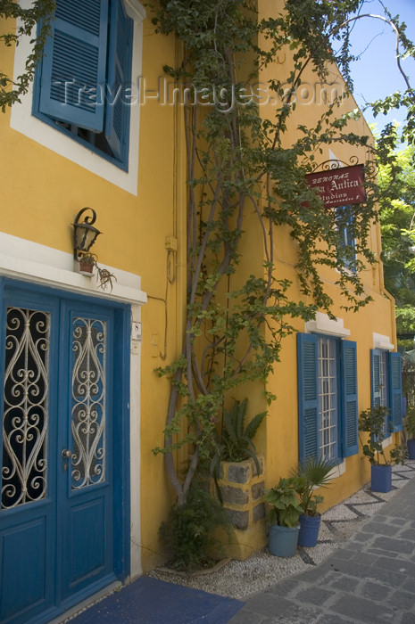 greece356: Greece, Dodecanese Islands, Rhodes: colourfull, bougainvillea-clad house in New Town - (c) Travel-Images.com - Stock Photography agency - Image Bank