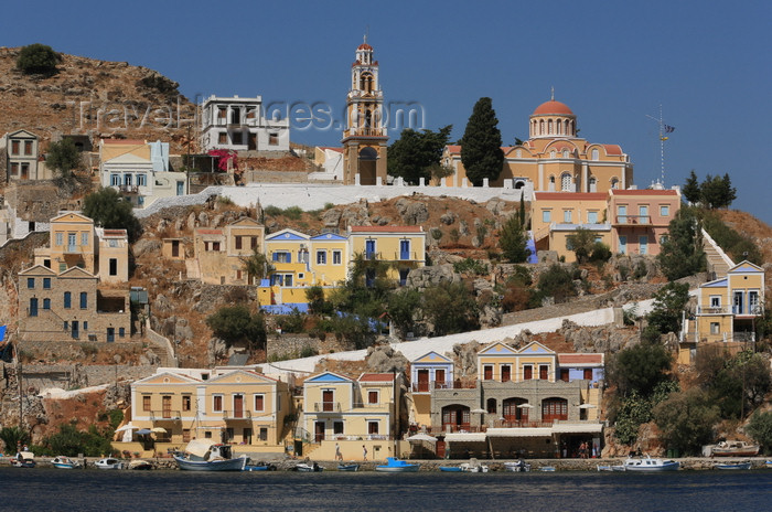 greece444: Greek islands - Dodecanes archipelago - Symi island - Symi town - houses and church on the waterfront - photo by A.Stepanenko - (c) Travel-Images.com - Stock Photography agency - Image Bank