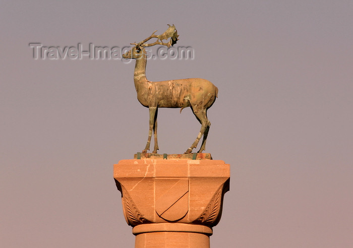 greece458: Greece - Rhodes island - Rhodes city - Mandraki Harbour - column at the entrance - deer - photo by A.Stepanenko - (c) Travel-Images.com - Stock Photography agency - Image Bank