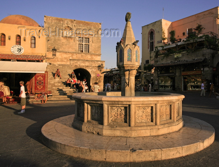 greece80: Greece - Rhodes island - Rhodes city - Old Town - Plateia Ippokratous - medieval fountain - photo by A.Stepanenko - (c) Travel-Images.com - Stock Photography agency - Image Bank