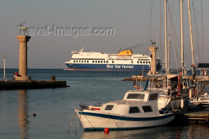 greece83: Greece - Rhodes island - Rhodes city - Mandraki Harbour - columns at the entrance - photo by A.Stepanenko - (c) Travel-Images.com - Stock Photography agency - Image Bank