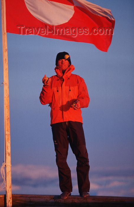 greenland79: Greenland, Apussuit: skier juggling in front of the Greenland flag - photo by S.Egeberg - (c) Travel-Images.com - Stock Photography agency - Image Bank