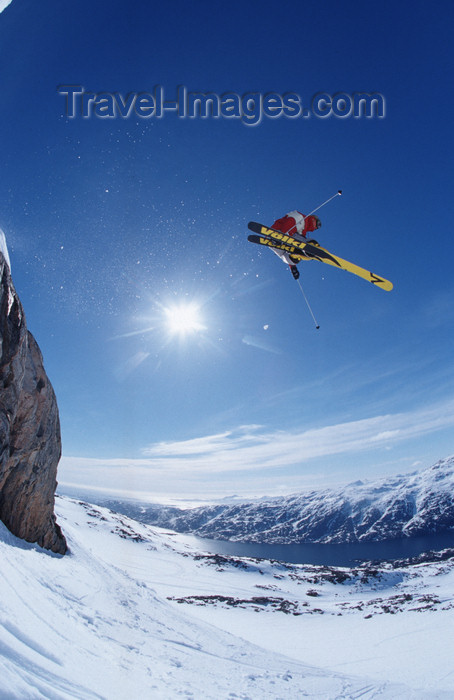 greenland80: Greenland, Apussuit: skier taking air off high ice cliff - sun - photo by S.Egeberg - (c) Travel-Images.com - Stock Photography agency - Image Bank