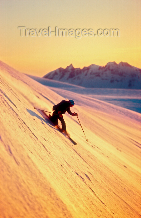 greenland86: Greenland, Apussuit: Telemark skier carving turns on steep slope - photo by S.Egeberg - (c) Travel-Images.com - Stock Photography agency - Image Bank